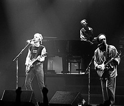 Dire Straits performing in Belgrade, Yugoslavia, (now Serbia) on 10 May 1985. Mark Knopfler, Clark, and Jack Sonni (left to right).