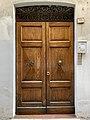Door with shell-shaped doorknobs in Reggio Emilia, Italy.jpg