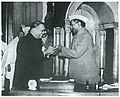 Dr. Babasaheb Ambedkar, chairman of the Drafting Committee, presenting the final draft of the Indian Constitution to Dr Rajendra Prasad on 25 November, 1949.jpg