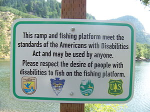 Americans with Disabilities Act of 1990 - The ADA sets standards for construction of accessible public facilities. Shown is a sign indicating an accessible fishing platform at Drano Lake, Washington.