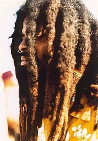 A man with dreadlocks.