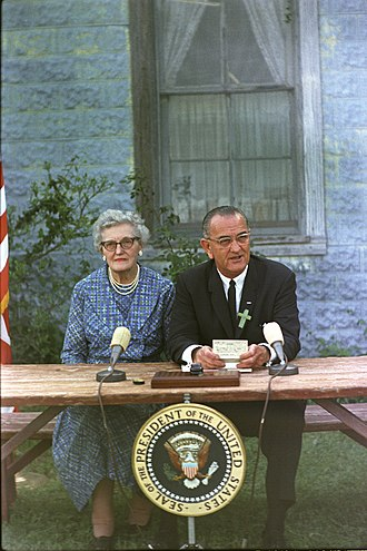 Elementary and Secondary Education Act - Lyndon B. Johnson at the ESEA signing ceremony, with his childhood schoolteacher Ms. Kate Deadrich Loney
