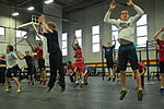 Eagle River High School hockey players work out with 1-Geronimo paratroopers 141025-A-ZX807-290.jpg