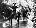 Ed Hunt crossing the L.A. River on horse in 1911 (00008087).jpg