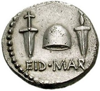 "Ides of March - Reverse side of a coin issued by Caesar's assassin Brutus in the autumn of 42 BC, with the abbreviation EID MAR (Eidibus Martiis – on the Ides of March) under a ""cap of freedom"" between two daggers"
