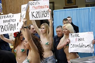 "Femen - Femen protest in Kiev during the 2010 Ukrainian presidential election against the election of Victor Yanukovych. The signs read ""The War Begins Today"" and ""Stop Raping the Country."""