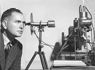 Eric Burhop - Burhop uses an optical pyrometer to measure the temperature within an apparatus