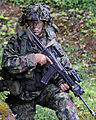 Estonian Land Force Cpl. Albert Benedik provides security during a simulated training exercise lane at the Hohenfels Training Area in Hohenfels, Germany, Aug. 27, 2014, during Saber Junction 2014 140827-A-ZZ999-007.jpg