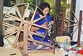 Female and spinning wheel for silk Thailand.jpg