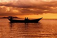 Fisherman at dusk on Lake Victoria.jpg