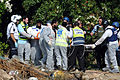 Flickr - The Israel Project - Israeli first responders remove one of three victims killed Nov 15 by a Hamas rocket. (8).jpg