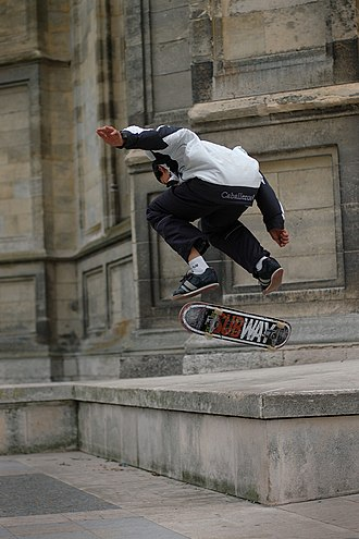 Skateboarding styles - Street skateboarding on the steps of the Orléans Cathedral.