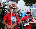 Folk singer with war bonnet at Broadstairs Folk Week 2017, Kent, England.jpg