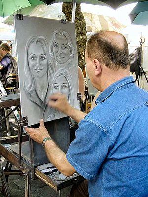 Place du Tertre - Street artist making a portrait.