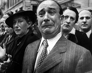 A Frenchman weeps as French battle standards are evacuated by sea out of reach of the German invaders in 1940.