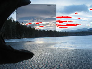 Graduated neutral-density filter - The same image with washed-out (white) pixels colored red. Note that clouds that are washed out without the GND filter show detail behind the filter.