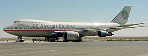 GE Aviation - General Electric used its 747-100 testbed in the 1990s for the GE90 which powers the Boeing 777-300ER, 777-200LR and 777F.