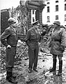 General Omar Bradley, General Dwight Eisenhower, and General George Patton, all graduates of West Point, survey war damage in Bastogne, Belgium. 1944-1945.jpg