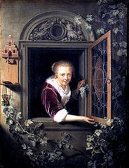 A Girl in a Window with a Bunch of Grapes