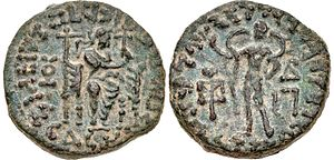 Sases - Coin of Gondophares-Sases (Circa AD 20-46). Obv King enthroned slightly right, raising hand, tamhga to left. Rev Male figure, wearing billowing veil, making a benediction gesture.