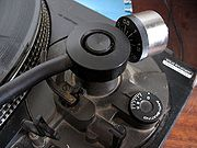 Adjustable counterweight; the dial below is the anti-skating adjustment.