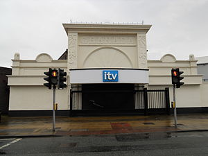 Granada Studios Tour - The Granada Studios Tour entrance lost its colour in 2011 and now bore the ITV logo. The embossed Granada is still present, the ITV logo has since been removed