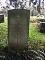 Gravestone of Flight Sergeant Oscar George Ackerman of the Royal Air Force Volunteer Reserve at the Church of St Ffraid, St Bride's-super-Ely, January 2021.jpg