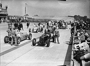 August Momberger - Drivers wait in their cars prior to the start of the 1934 French Grand Prix. Momberger is in car 10, on the second row