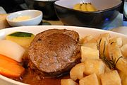 Grilled beef tenderloin with port wine sauce, roasted rosemary potatoes, carrots and zuchini.jpg