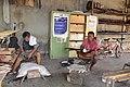 Guitar artisans at work (9237844594).jpg