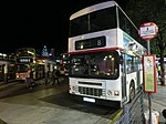 HK TST night Salisbury Road Star Ferry Piers Bus Terminus 尖沙咀碼頭巴士總站 KMBus 8 stop sign Mar-2013.JPG