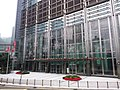 HK tram 64 view Admiralty 金鐘道 Queensway 長江集團中心 Cheung Kong Center front door n flagpoles December 2019 SSG 03.jpg