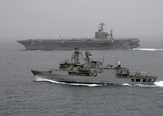 Royal New Zealand Navy - The RNZN Frigate HMNZS ''Te Mana'' alongside the Nimitz-class aircraft carrier USS ''Abraham Lincoln'' in the North Arabian Sea whilst taking part in Operation ''Enduring Freedom''.