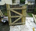 Handyman project repairing a gate with new slats and springs and latches.JPG