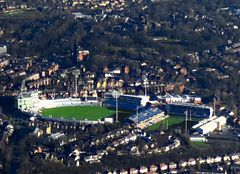 Two large stadia surrounded by terraced houses.