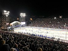 A football stadium with a hockey rink in the center