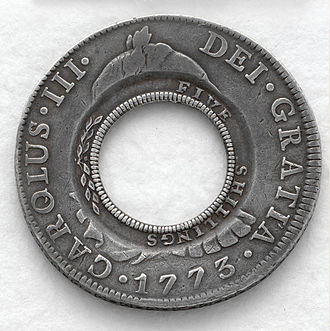 "Holey dollar - A New South Wales ""holey dollar"", the first distinct currency of Australia."