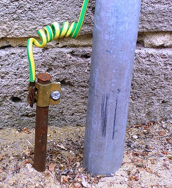 A typical earthing electrode (left) at a home ...
