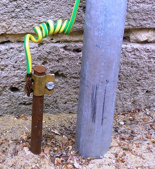 A typical earthing electrode (left of gray pipe), consisting of a conductive rod driven into the ground, at a home in Australia. Most electrical codes specify that the insulation on protective earthing conductors must be a distinctive color (or color combination) not used for any other purpose. HomeEarthRodAustralia1.jpg