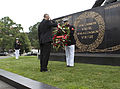 Honorary Marine Daran Wankum, left, salutes as a Marine lance corporal places a wreath during a wreath laying ceremony at the Marine Corps War Memorial in Arlington, Va, June 13, 2013 130613-M-KS211-005.jpg