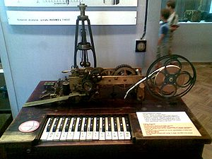 Ticker tape - Hughes telegraph (1866-1914), first telegraph printing text on a paper tape. Manufactured by Siemens & Halske, Germany; range: 300-400 km