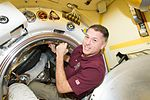 ISS-50 Shane Kimbrough signs a bulkhead in the Poisk module.jpg