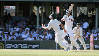 Caught - An Australian fielder runs to take a catch