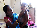 It's a boy - Khol Kajal kanmashi kan mai eyeliner infants evil eye Buri nazar drishti bommai काजल கண் மை surma Tamil Nadu village India Documentary Featur story jpg photo IMG 3192 signed.jpg