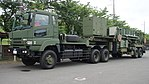 JASDF MIM-104 Patriot PAC-2 7t Tractor(Mitsubishi Fuso Super Great, 49-2211) with M901 Launching Station(49-3140) left front view at JMSDF Maizuru Naval Base July 29, 2017 02.jpg