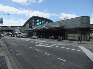 Jackson Heights–Roosevelt Avenue/74th Street (New York City Subway) - The station complex and adjoining bus terminal as seen from Broadway and 75th Street