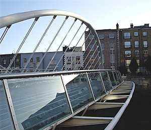 James Joyce Bridge - Detail of the bridge. 15 Usher's Island is the redbrick house obscured by the arch.