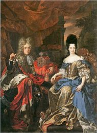 A periwigged man and a woman are seated against a sun-set milieu. The man is embracing a crown with his left hand; while the lady holds an olive branch in her right. The man wears a black armour; the lady, a silk dress.
