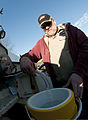 Jeff Heath, of CMS Oilfield Services, fills a container with water for a resident affected by the Elk River water contamination at Poca High School in Poca, W.Va., on Jan. 11, 2014 140111-Z-LQ742-023.jpg
