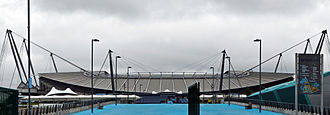 City of Manchester Stadium - Panorama of north end of stadium as viewed from southern approach along Joe Mercer Way